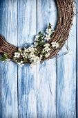 image of wooden door  - Wooden garland covered with spring apple blossom hanging on wooden door - JPG