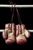 picture of boxing ring  - Vintage boxing gloves hanging on boxing ring tropes - JPG