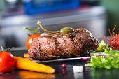 foto of porterhouse steak  - Grilled Beef steak with vegetable decoration - JPG