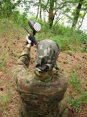 foto of splayed  - paintball player with weapon attack target on nature - JPG