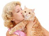 stock photo of beautiful senior woman  - in studio portrait of a beautiful senior woman kissing her beloved cat - JPG
