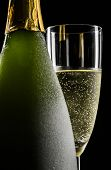 picture of flute  - Champagne flute and bottle on black background - JPG