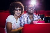 pic of cinema auditorium  - Young couple watching a 3d film at the cinema - JPG
