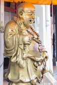 stock photo of gold tooth  - Detail from the Buddha Tooth Relic Temple in Singapore - JPG