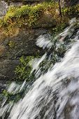 stock photo of stonewalled  - Running water cascade waterfall streaming splashes - JPG