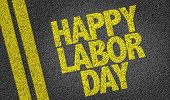 image of labourer  - Happy Labour Day written on the road - JPG