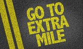 stock photo of mile  - Go To Extra Mile written on the road - JPG