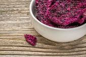 stock photo of ceramic bowl  - slices of dried red dragon fruit in a white - JPG