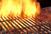 picture of ember  - Empty Charcoal Grill With Glowing Embers and Flames Of Fire In The Background - JPG