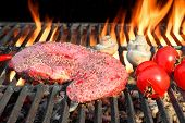 foto of bloody  - Raw Fresh Bloody Strip Steak Tomatoes And Mushrooms On Hot Grill - JPG