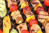 foto of kebab  - Delicious Mixed Kebabs BBQ On Hot Grill Background - JPG