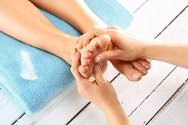 pic of pedicure  - Woman in a beauty salon for pedicure and foot massage - JPG