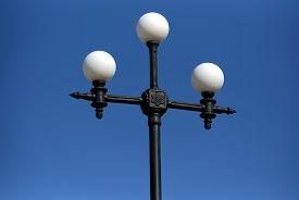stock photo of light-pole  - a lone light pole on blue sky background - JPG