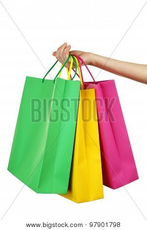 Female Hand Holding shopping bags on white background