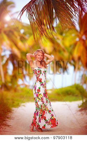 Beautiful Young Girl Enjoys Vacation In Tropical Palm Grove