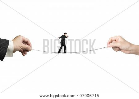 Businessman Balancing On Tightrope With Man And Woman Hands Holding
