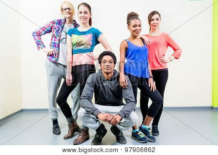 Young men and women in dance class posing