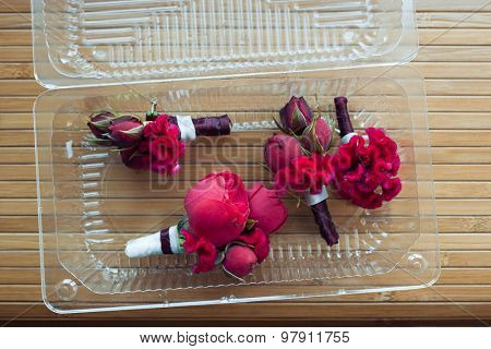 boutonniere with red rose and peony for groom and friends
