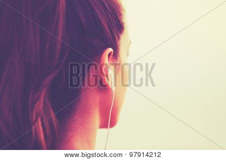 Active Sports Lifestyle with Modern Technology. Young fitness woman listening to music