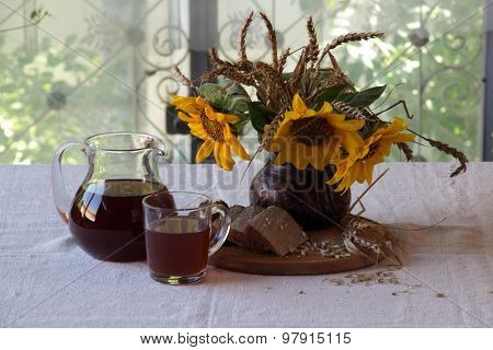 Still-life With A Bouquet Of Sunflowers And Kvass (kvas) ? ?????????? A Jug