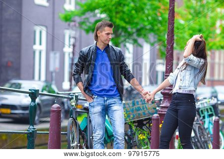 Happy couple in love walking in european city visiting Amsterdam, Netherlands