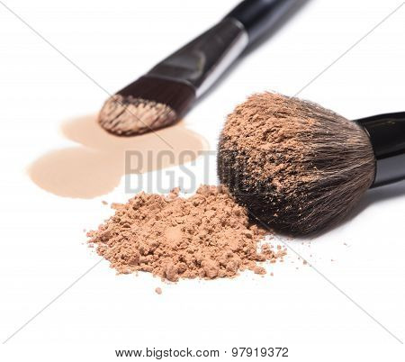 Liquid Foundation And Loose Cosmetic Powder With Makeup Brushes