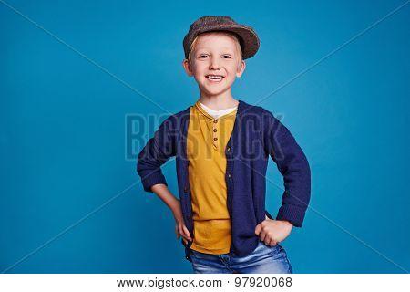 Cute little boy in casualwear looking at camera