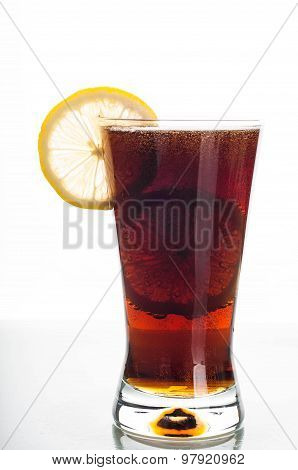 Glass Of Cola With Sliced Lemon