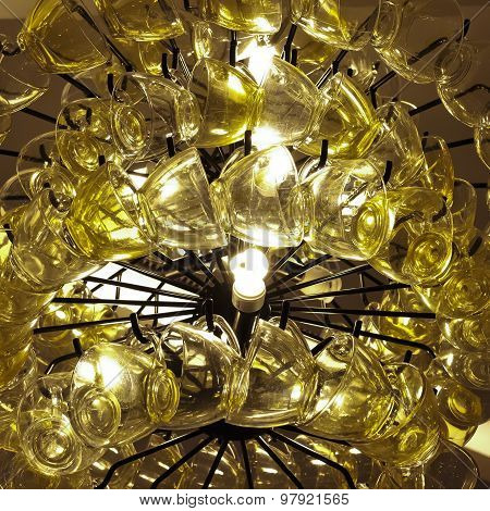 Close Up Contemporary Chandelier Made Of Many Yellow Coffee Cups.