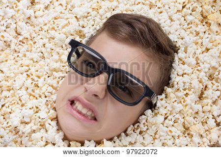 Evil Ferocious Young Boy In Stereo Glasses Looking Out Of Popcorn