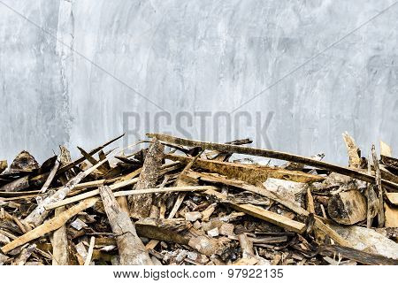 Cement wall and scraps of wood foreground