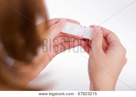 Young Women Checking Pregnancy Test.