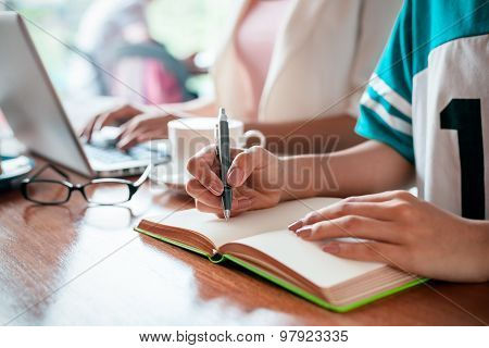 writer in a cafe
