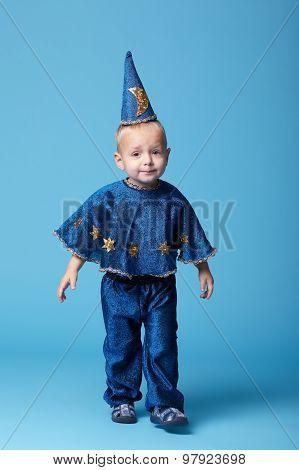 little magician portrait on blue background