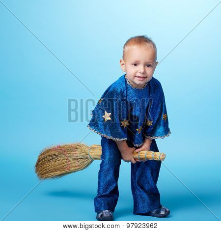 Little boy flying on broom