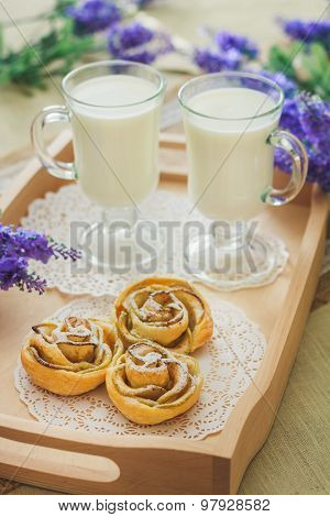 Tasty homemade apple cakes over wooden background