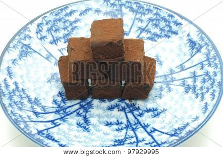 Chocolate stacking on dish