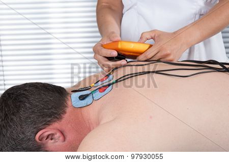 Man With Electrostimulator Electrodes On His Back