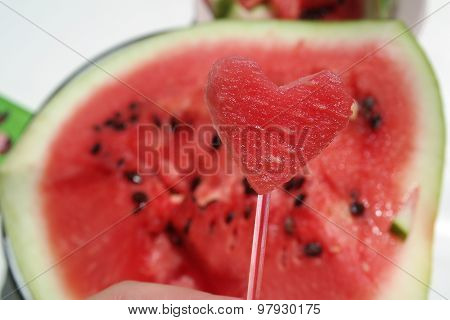 red juicy beautiful charming heart of the watermelon on the background of watermelon