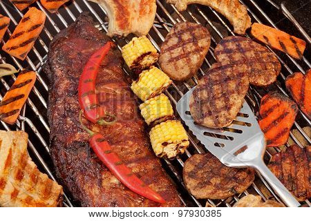 Spareribs, Steaks, Hamburger Patties, Corn And Pepper On The Grill