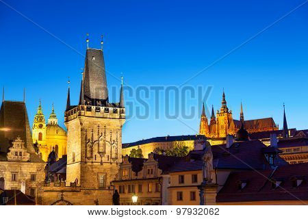 Twilight Scene Of Prague With Charles Bridge Tower And St Vitus Cathedral And Castle In The Distance