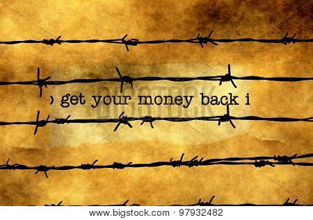 Get Your Money Back Text Against Barbwire