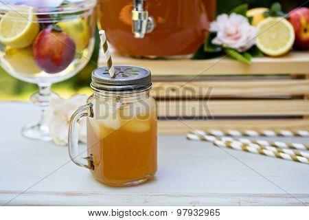 Peach cardamom lemonade with ice cubes