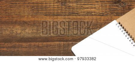 Open Spiral Bound Notebook With White Pages On Wood Background