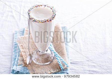 White chocolate milkshake in tall glass