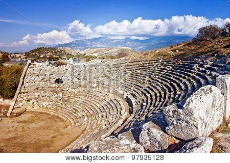 Amphitheatre in Letoon - sanctuary of goddess Leto near the ancient Lycian city Xanthos. Turkey