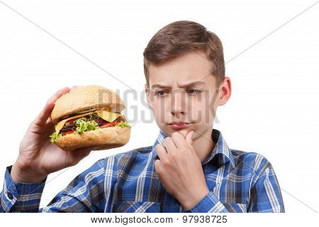 Boy Looks At A Cheeseburger And Thinking.