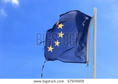 Ripped EU flag fluttering in the wind