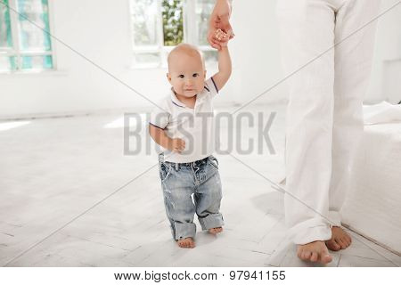 young father with his nine months old son at home