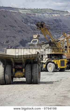 Heavy Dump Trucks At The Loading Queue